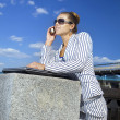 Businesswoman using her mobile phone — Stock Photo