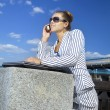 Businesswoman using her mobile phone - Stock Photo