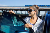 Woman in sunglasses near the car — Stock Photo