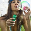 Hippy blowing soap bubbles — Stock Photo