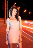 Woman on night road — Stock Photo