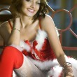 Sexy girl wearing santa claus clothes - Stok fotoğraf