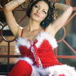 Girl wearing santa claus clothes - Stockfoto