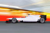 Formula one car on empty road — Stock Photo