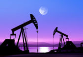 Oil pumps at night — Stock Photo