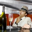 Stock Photo: Young gangster drinking in cabaret