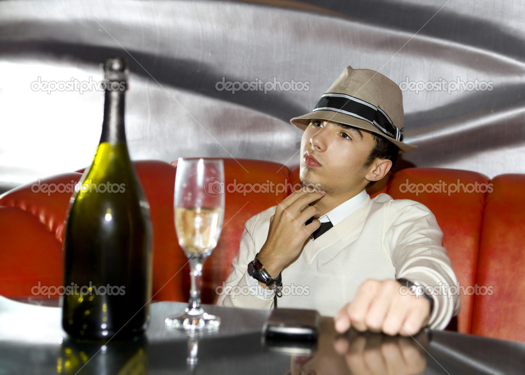 Attractive young gangster drinking in cocktail party at cabaret — Stock Photo #3876225