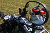 Red quad bike in rear view mirror — Stock Photo