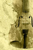 Grunge music background with old fiddle — Stock Photo