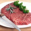 Steak on white plate - Stok fotoğraf