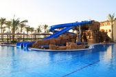 Slide in tropical resort — Stock Photo