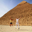 Stockfoto: Hapiness at pyramids in Egypt