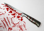 Blood spattered knife — Stock Photo