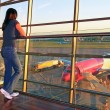 Woman waiting for a plane on airport - Stock Photo