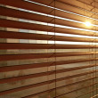 Sunlight behind vertical blinds — Stock Photo #3843027