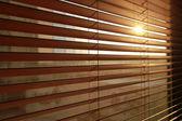 Sunlight behind vertical blinds — Stock Photo