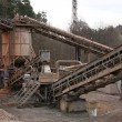 Stone quarry with silos and conveyor - Photo