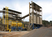 Stone quarry with silos and conveyor — Stock Photo