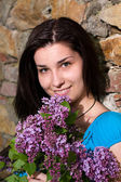 Happy young woman with flower — Foto Stock