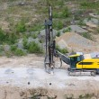 Stock Photo: Drilling machine in open cast mining quarry