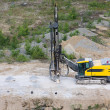 Drilling machine in open cast mining quarry — Stock Photo #3483828