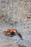 Digger in a quarry — Stock Photo