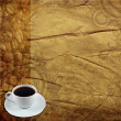 White coffee cup on old paper — Stock Photo
