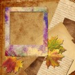 Royalty-Free Stock Photo: Autumn polaroid photo frame with leaves, fabric  and paper