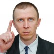 Businessman with the raised finger — Stock Photo
