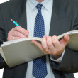 Businessman writing in the file folder — Stock Photo