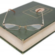 Glasses lying on an old book — Stock Photo