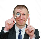 Smiling businessman with a raised finger — Stock Photo