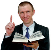 Smiling businessman with a book — Stock Photo