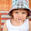 Child drinking juice through a straw — Stock Photo #3267109