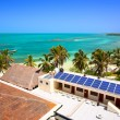 Stock Photo: Beach with a building with a solar panel on the Isla Contoy, Mexico