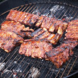 Stock Photo: Grilled pork ribs on bbq grill (shallow DOF)