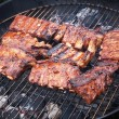 Grilled pork ribs on bbq grill (shallow DOF) - Stock Photo