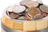 Overflowing barrel with various coins — Stock Photo
