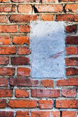 Old brickwork and Inscriptions plate — Stock Photo