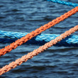 Stock Photo: Mooring ropes securing ships