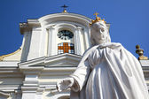 Virgin Mary white statue against Church — Stock Photo