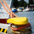 Stock Photo: Bollard and mooring lines