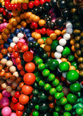Colorful wooden neklaces — Stock Photo