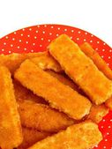 Fish fingers on the red plate. Isolation — Stock Photo
