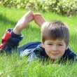 Stock Photo: Boy lay on grass