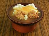 Yogurt with honey and walnuts — Stock Photo