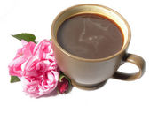 A cup of coffee and a pink rose — Stock Photo