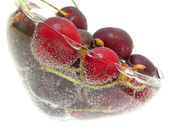 Ripe cherry in the soda — Stock Photo