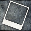 Grungy jeans background with instant frame — Stock Photo
