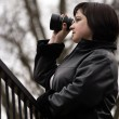 Woman with lens — Stock Photo